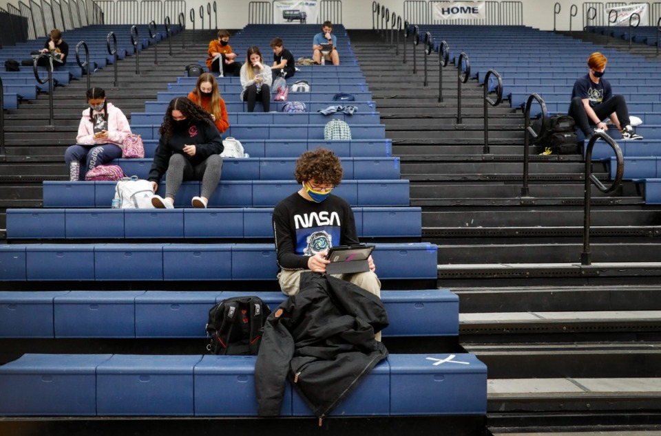<strong>Arlington High School students spread out on bleachers while doing classwork in their P.E. class on Thursday, Jan. 7, 2021. Arlington Community Schools and the Lakeland School System are prepping for less restrictive learning conditions in the coming school year.</strong>(Mark Weber/The Daily Memphian file)