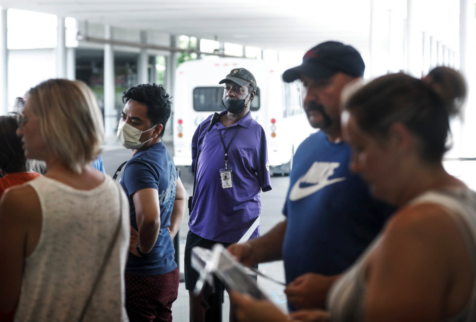 <strong>Kenneth Shives, (middle) who was born with no arms, directs customers to their next location on Wednesday, July 28, 2021 at Graceland. The tight-staffing market has been a boon for SRVS Memphis, which places disabled people in the workforce.</strong> (Mark Weber/The Daily Memphian)