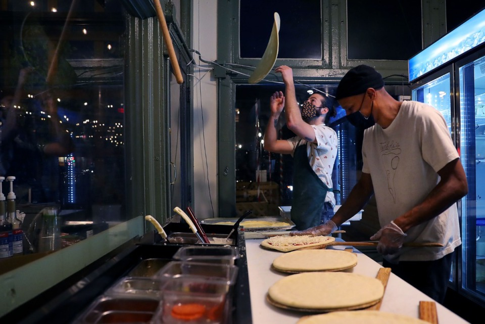 <strong>Tamboli&rsquo;s Pasta &amp; Pizza &mdash; where&nbsp;Miles Tamboli (left) tossed pizza dough successful  the aerial  portion    Carlus Perry prepped pizzas connected  Jan. 13, 2021 &mdash; is 1  of 13 eateries participating successful  Memphis Dining Week.&nbsp;</strong>(Patrick Lantrip/Daily Memphian)
