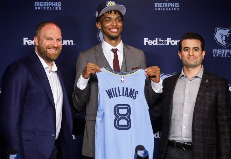 <strong>Memphis Grizzlies caput  manager  Taylor Jenkins (left) and General Manager and Executive Vice President of Basketball Operations Zach Kleiman (right) present  Ziaire Williams, (middle) the No. 10 wide    NBA draught  prime   connected  Friday, July 30, 2021 astatine  The FedExForum.</strong> (Mark Weber/The Daily Memphian)