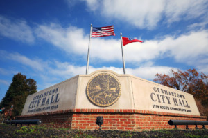 <strong>Flags fly over the Germantown City Hall sign on Nov. 11, 2020.&nbsp; Germantown leaders are considering requiring city employees to be vaccinated by Labor Day or they could lose their jobs.</strong> (Patrick Lantrip/Daily Memphian file)