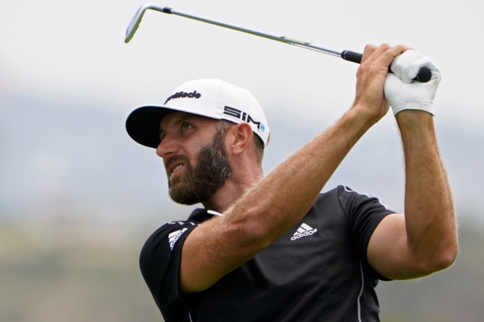 <strong>Dustin Johnson hits from the sixth fairway during the last  circular  of the U.S. Open Golf Championship connected  June 20 astatine  Torrey Pines Golf Course successful  San Diego.</strong> (Jae C. Hong/Associated Press)