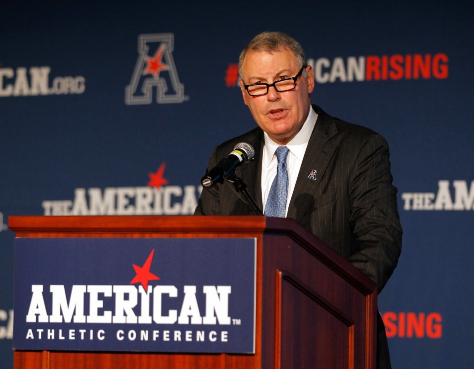 <strong>American Athletic Conference Commissioner Mike Aresco addresses the media during an NCAA assemblage   shot   media time  successful  Newport, R.I. Aresco vehemently denied that his league   has ever   &ldquo;plotted&rdquo; with ESPN to undermine different  league  by poaching its schools.</strong>&nbsp;(Stew Milne/AP file)