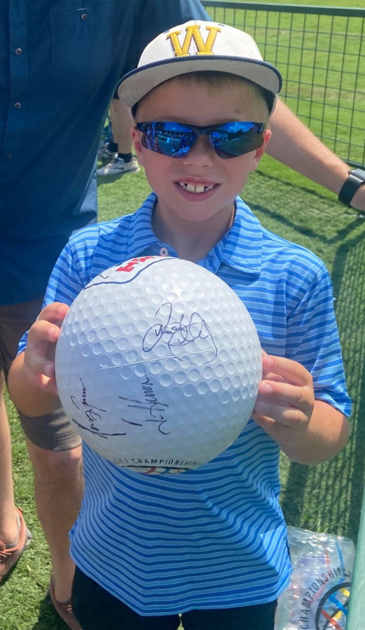 <strong>Brendan Riley, 7, of Wynne, Arkansas, holds up a large golf ball that several professional golfers signed Wednesday at TPC Southwind.</strong>&nbsp;(Ronnie Ramos/Daily Memphian)&nbsp;