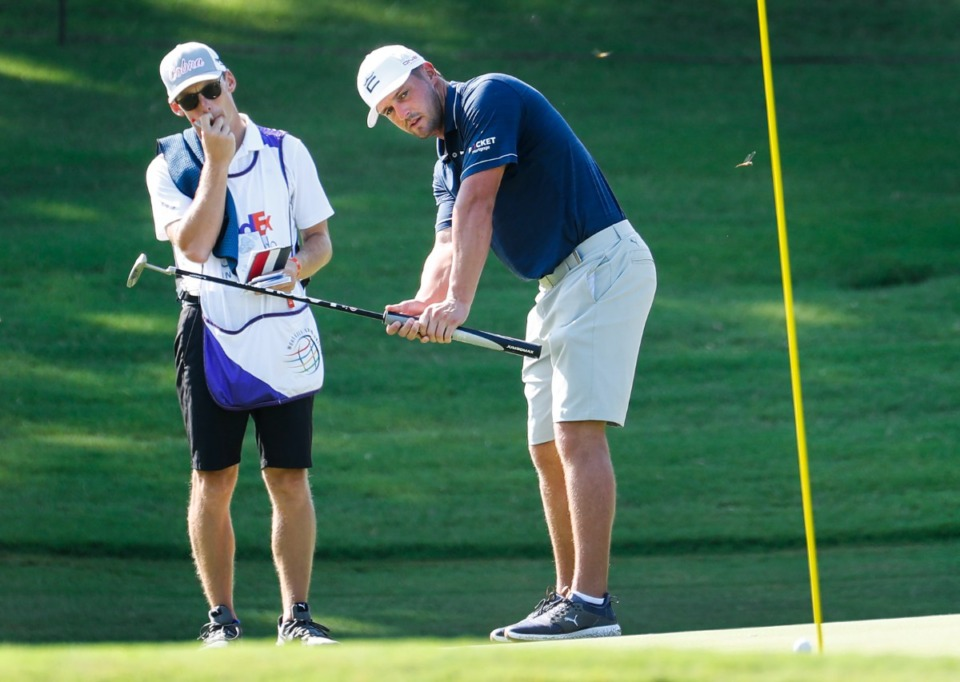 <strong>PGA golfer Bryson DeChambeau (right) and his caddy watch his putt during the WGC-FedEx St. Jude Invitational pro-am on Wednesday, Aug. 4, at TPC Southwind.</strong> (Mark Weber/Daily Memphian)