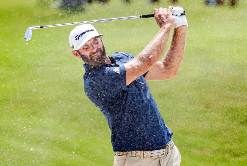<strong>PGA golfer Dustin Johnson hits out of the bunker on the 18th fairway&nbsp;during the first round of the WGC-FedEx St. Jude Invitational on Thursday, Aug. 5, 2021, at TPC Southwind.</strong> (Mark Weber/The Daily Memphian)