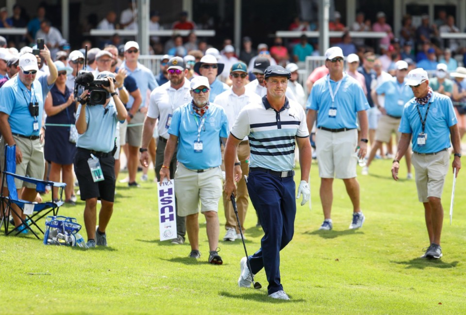 <strong>PGA golfer Bryson DeChambeau watches his shot after hitting from the rough on the 18th fairway&nbsp;during the first round of the WGC-FedEx St. Jude Invitational on Thursday, Aug. 5, 2021, at TPC Southwind.</strong> (Mark Weber/The Daily Memphian)