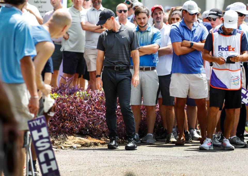 <strong>PGA golfer Rory McIlroy looks at his ball that landed on the cart path on the 18th hole&nbsp;during the first round of the WGC-FedEx St. Jude Invitational on Thursday, Aug. 5, 2021, at TPC Southwind.</strong> (Mark Weber/The Daily Memphian)