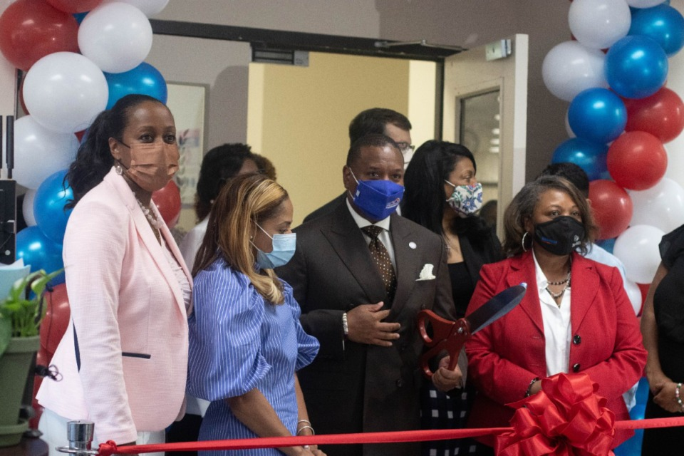 <strong>Shelby County Schools Superintendent Joris Ray prepares to cut the ribbon on the district's new Medical District High School on Thursday, Aug. 5. The school is located on the campus of Southwest Tennessee Community College.</strong> (Daja E. Henry/Daily Memphian)