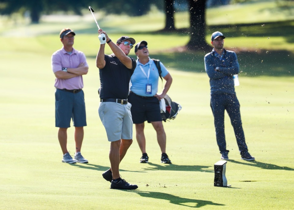 <strong>PGA golfer Phil Mickelson (front) hits his fairway shot while taking part in the WGC - FedEx St. Jude Invitational pro-am on Wednesday, August 5, 2021 at TPC Southwind.</strong> (Mark Weber/The Daily Memphian)