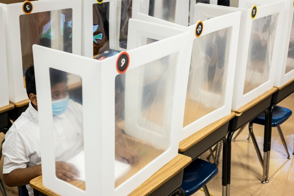 <strong>Students were separated by sneeze barriers in classrooms at Bruce Elementary on Monday, Aug. 9, Shelby County Schools&rsquo; first day of class.</strong> (Brad Vest/Special to the Daily Memphian)