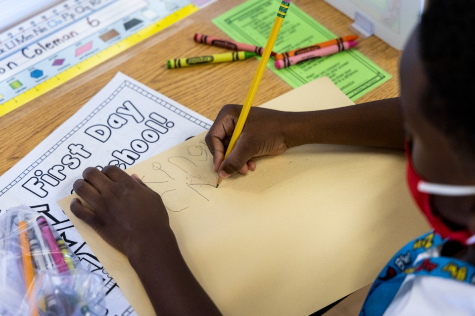 <strong>A student does class work at Bruce Elementary on Monday, Aug. 9, Shelby County Schools&rsquo; first day of school.</strong> (Brad Vest/Special to the Daily Memphian)