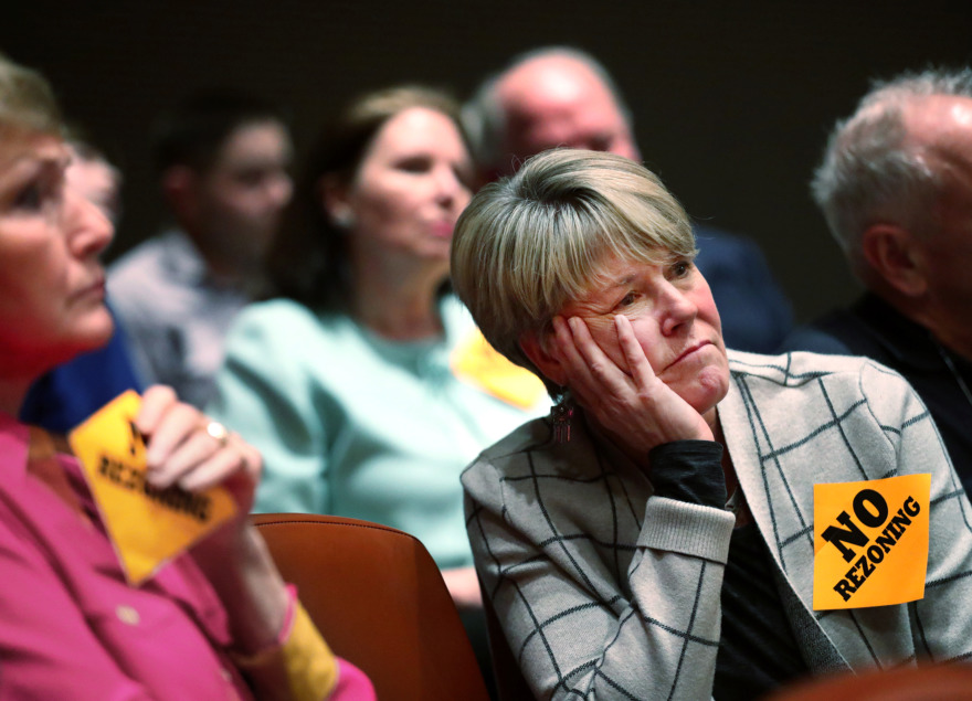 <strong>Germantown resident Cathy Lynn listens as advocates for the proposed rezoning of residential land a block south of her Grove Forest Cove home make their case to the Germantown Planning Commission on Tuesday, Feb. 5, 2019.</strong> (Houston Cofield/Daily Memphian)