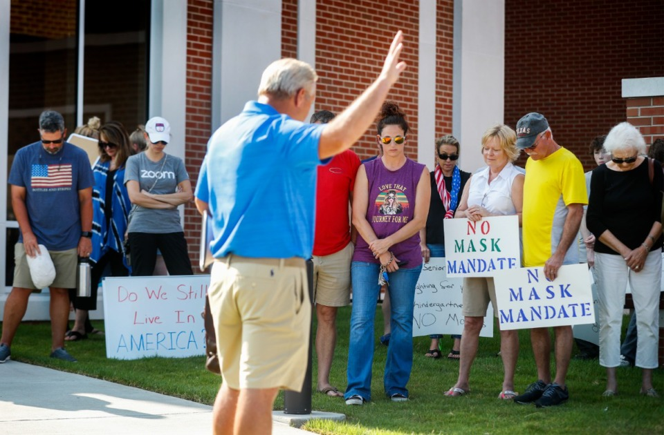 <strong>Protesters gather outside Collierville Schools&rsquo; administration building on Monday, Aug. 9, to show their opposition to the Shelby County Health Department&rsquo;s mandate for universal masking in schools.</strong> (Mark Weber/Daily Memphian)