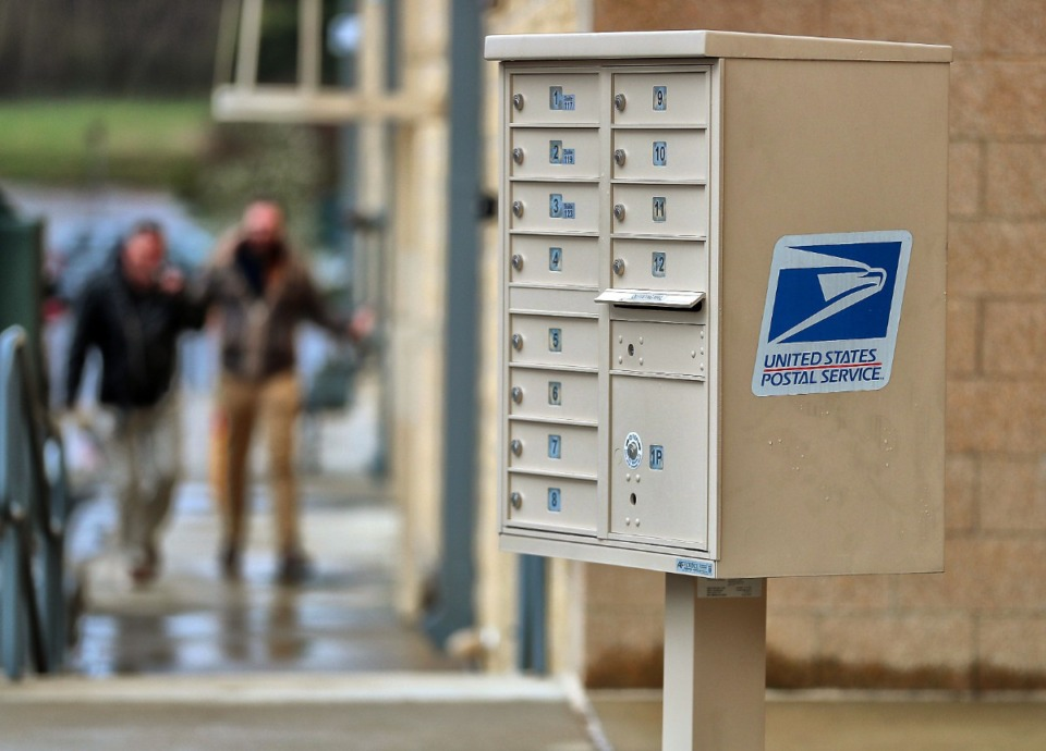 <strong>A cluster mailbox for businesses at 6450 Poplar in East Memphis is similar to the kind of mailbox that the USPS wants installed in every new project, from apartments to single-family developments. The concept of cluster mailboxes remains a headache for many developers, builders and residents.</strong> (Jim Weber/Daily Memphian file)