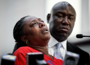 <strong>Attorney Ben Crump (right) comforts Tasheta Motley, the sister of Alvin Motley Jr., during a press conference on Tuesday, Aug. 10, at Mt. Olive Cathedral CME Church. Motley Jr., was shot and killed at a Kroger fuel station.</strong> (Mark Weber/Daily Memphian)