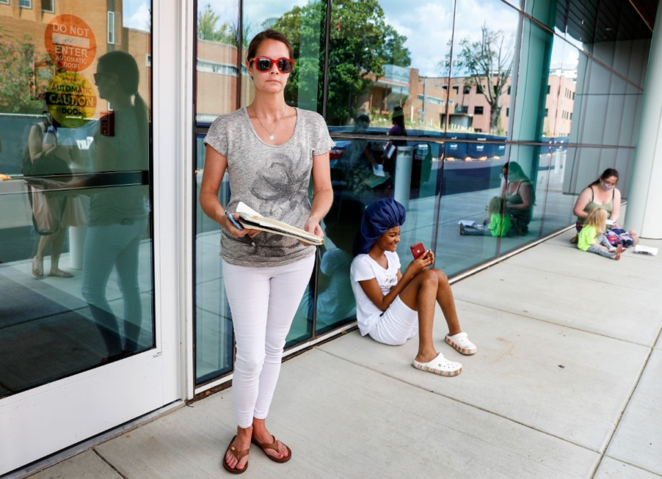 <strong>Julie Fisher (left), with the Tennessee Parents on Telegram, speaks to the media about mandatory masks for students on Tuesday, Aug. 10, outside the Shelby County Health Department.</strong> (Mark Weber/Daily Memphian)