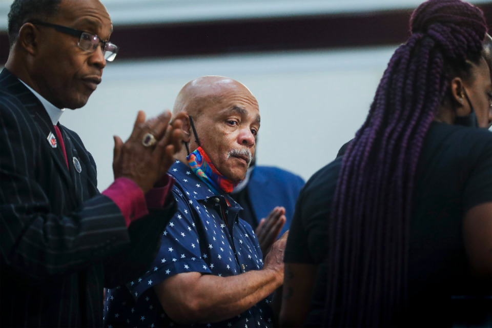 <strong>Alvin Motley Sr. (middle), the father of Alvin Motley Jr., sheds tears during a press conference on Tuesday, Aug. 10, at Mt. Olive Cathedral CME Church. Motley Jr. was shot and killed at a Kroger gas station allegedly by a security guard. &ldquo;I want justice for my son,&rdquo; Motley Sr. said.</strong> (Mark Weber/Daily Memphian)