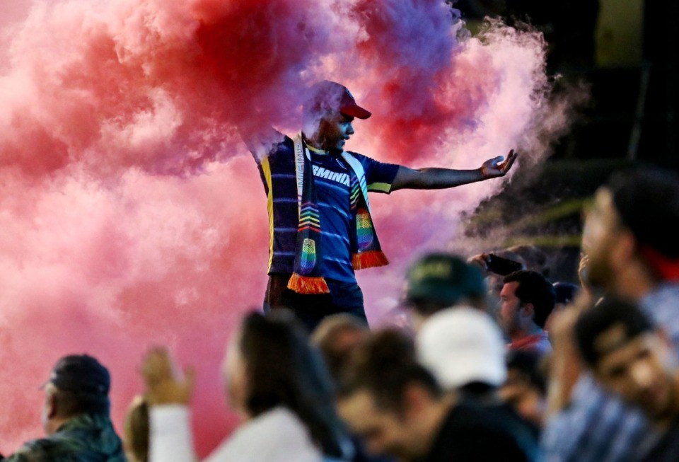 <strong>Memphis 901 FC fan Chris Smith hypes up the crowd after a goal against Colorado Springs during a Aug. 10, 2021 home match at AutoZone Park.</strong> (Patrick Lantrip/Daily Memphian)