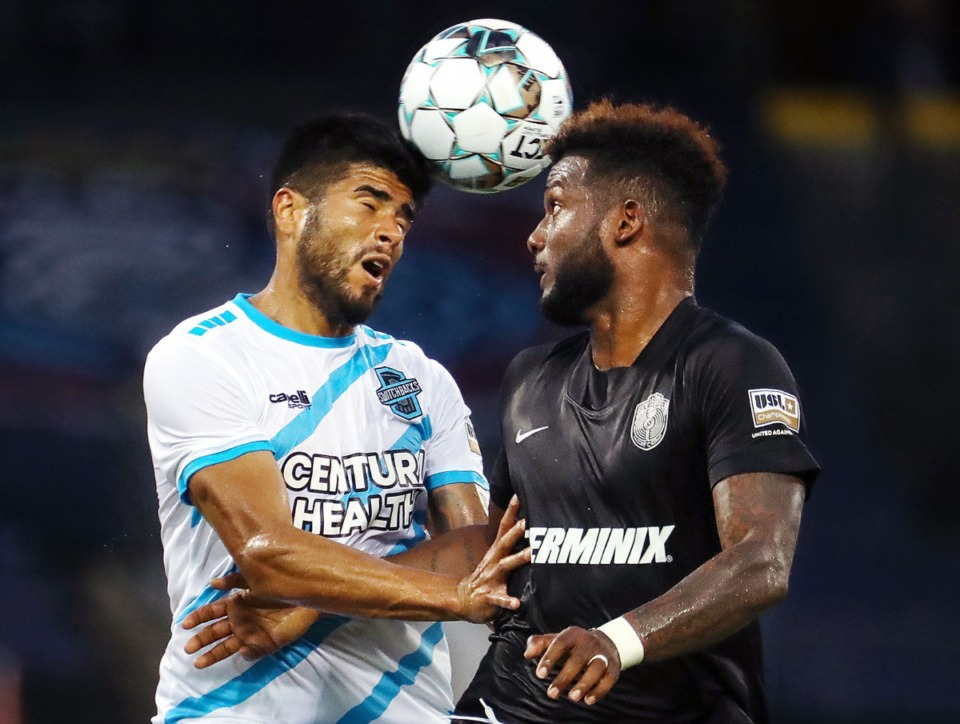 <strong>Memphis 901 FC forward Michael Salazar (11) goes up for a header against a Colorado Springs defender during a Aug. 10, 2021 home match at AutoZone Park.</strong> (Patrick Lantrip/Daily Memphian)
