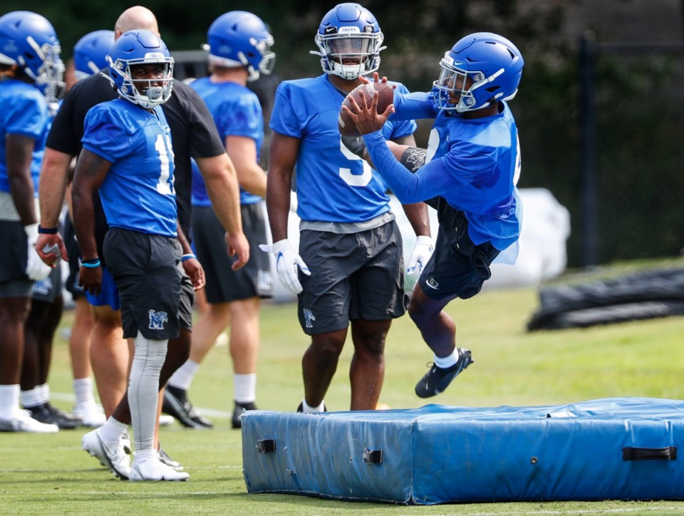 <strong>Memphis receiver Calvin Austin III makes a catch during first day of practice.</strong> (Mark Weber/The Daily Memphian)