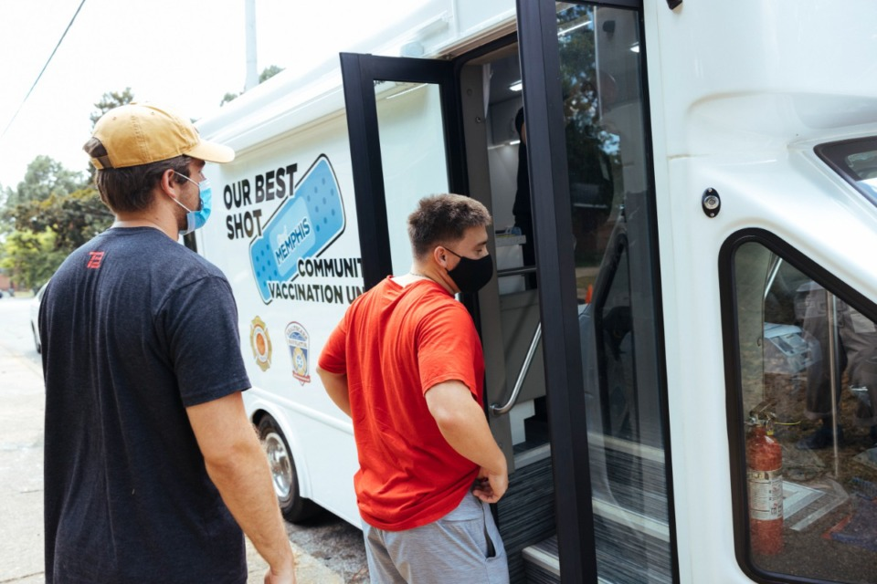 <strong>Best friends Tucker Pitman (left) and Alex Langford enter the mobile unit to receive COVID-19 vaccinations Thursday, Aug. 12, at Carpenter Art Garden in Binghampton.</strong> (Ziggy Mack/Special to The Daily Memphian)