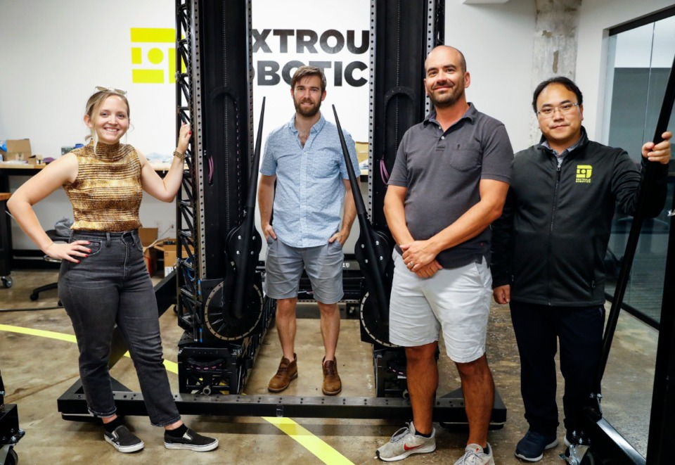 <strong>Dextrous Robotics team members (left to right) roboticist Jess Moss, co-founder and CTO Sam Zapolsky, co-founder and CEO Evan Drumwright and software engineer Giho Jang discuss the robot they built to unload trucks and shipping containers.</strong>&nbsp;(Mark Weber/The Daily Memphian)