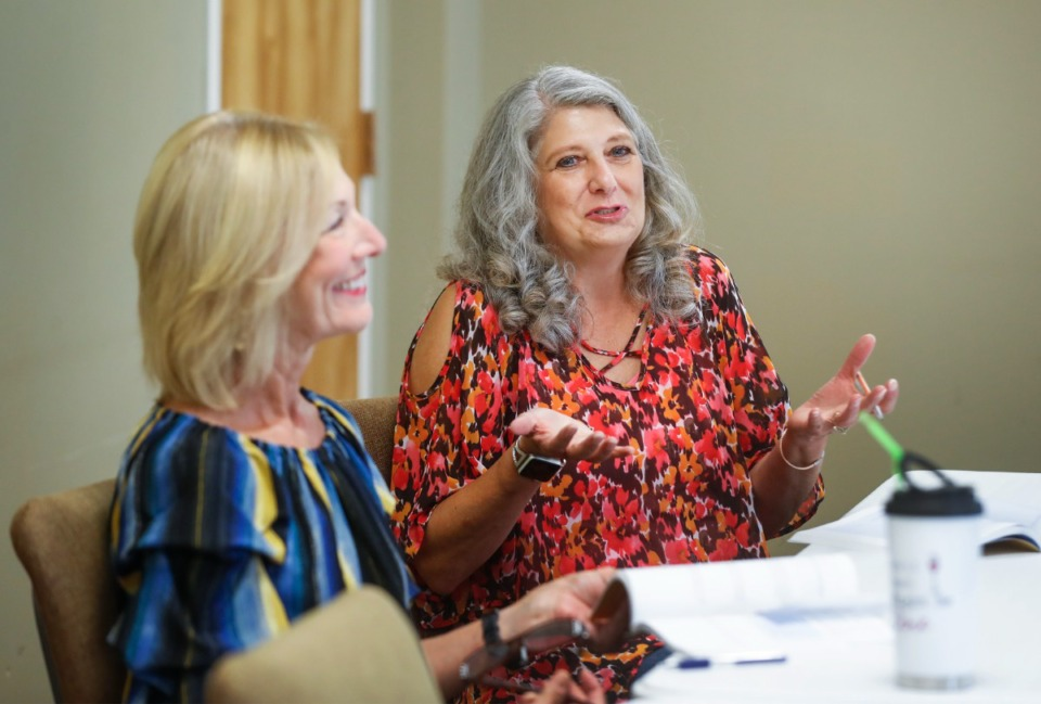 <strong>Cathy Hisky (right) and Carolyn Foster discuss a Bible passage during the &ldquo;Jesus &amp; Me&rdquo; Bible study group on Thursday, July 29, at Collierville United Methodist Church.</strong> (Mark Weber/Daily Memphian)