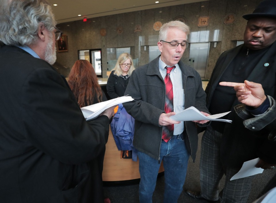 <strong>Steve Mulroy (center) is one of Shelby County&rsquo;s most vocal advocates for a new voting system with hand-marked paper ballots.</strong> (Daily Memphian file)&nbsp;