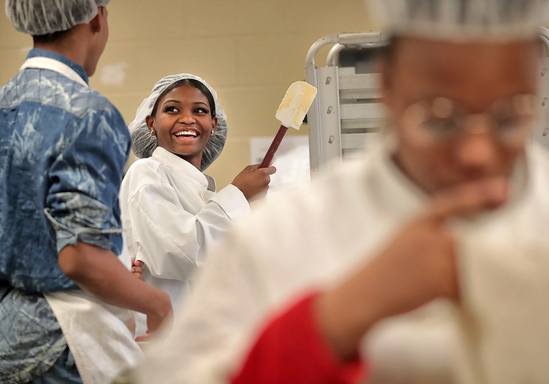 <strong>Culinary arts students Joshua Ivory (left) and Katrice Jones bake cookies during class at the Trezevant Career and Technology Center where high school students from the Raleigh-Frayser area can attend classes in vocational programs like culinary arts, cosmotology and finance. In an effort to get kids on a career track earlier, Sen. Katrina Robinson is backing a piece of legislation that would help middle schools start career and technical education courses.</strong> (Jim Weber/Daily Memphian)