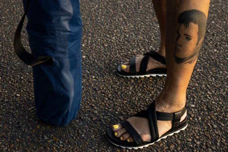 <strong>&ldquo;When I come back next year there will be more added to it,&rdquo; Elvis fan Becky Cornelius said about her Elvis tattoo as she stood outside Graceland during the candlelight vigil Sunday, Aug. 15, 2021.</strong> (Brad Vest/Special to The Daily Memphian)