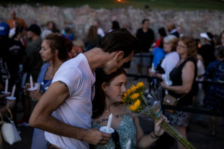 <strong>Kyler Campbell (left) kisses his girlfriend, Ashlyn Farris, while waiting in line along Elvis Presley Boulevard Sunday, Aug. 15, during the Elvis Week Candlelight Vigil. The annual vigil near Presley&rsquo;s grave at Graceland commemorates the anniversary of the singer&rsquo;s death on Aug. 16, 1977.</strong> (Brad Vest/Special to The Daily Memphian)