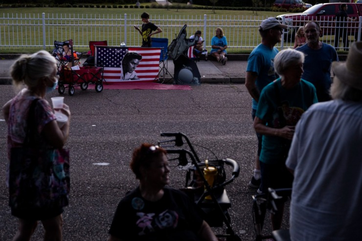 <strong>Fans gather along Elvis Presley Boulevard during the Elvis Week 2021 Candlelight Vigil outside Graceland.</strong> (Brad Vest/Special to The Daily Memphian)