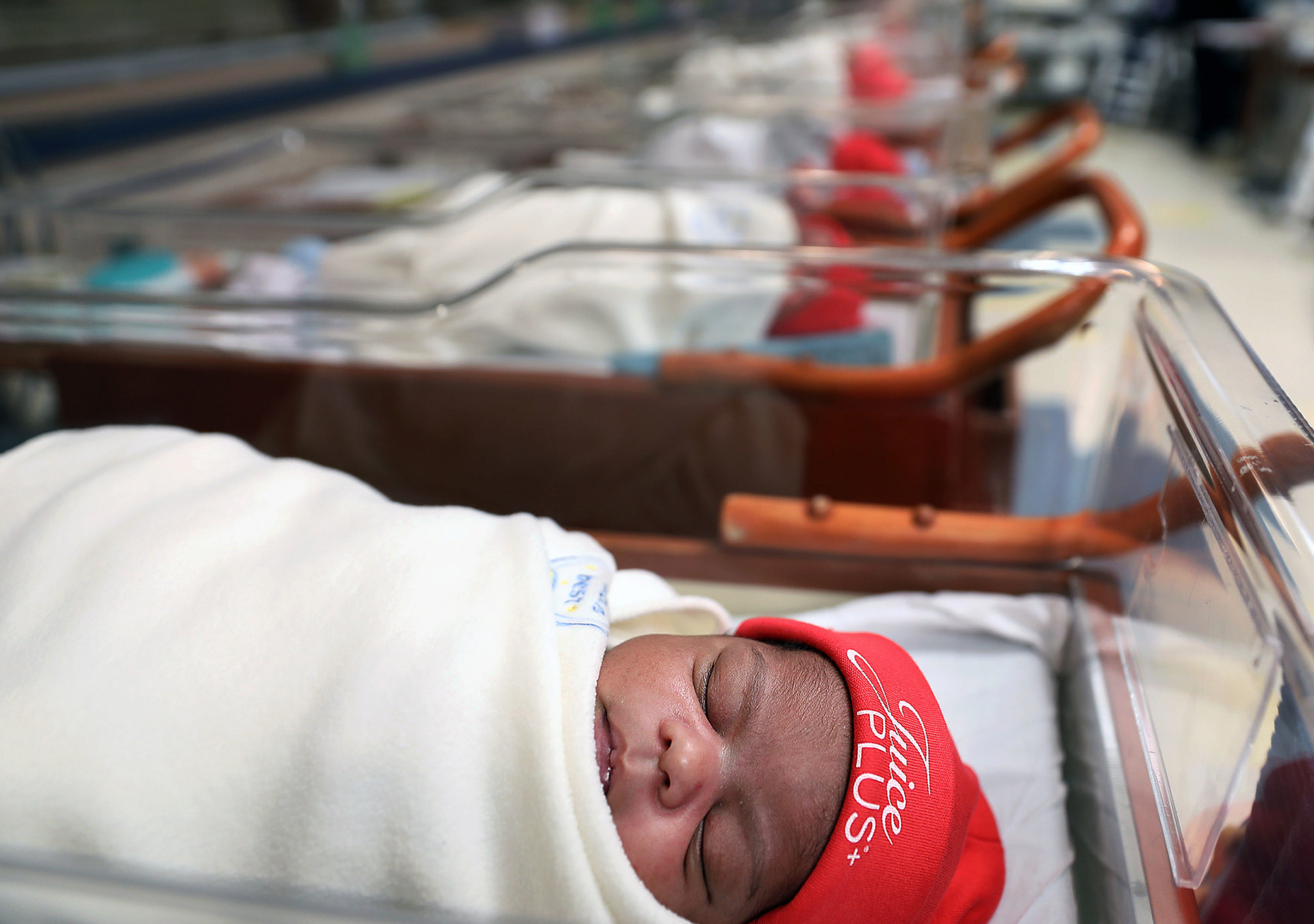 <strong>On Wednesday, Feb. 6, about a dozen newborn babies were lined up in the Baptist Memorial Hospital for Women's nursery window wearing red beanies. The red hats are part of an awareness campaign by the American Heart Association informing new parents that congenital heart defects are the most common type of birth defect, affecting about 40,000 births, or 1 in 100 newborns, each year.</strong> (Patrick Lantrip/Daily Memphian)