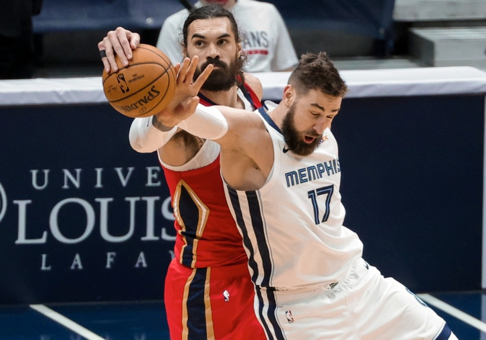 <strong>Former Grizzlies center Jonas Valanciunas (17) battles former Pelicans center Steven Adams (12) on Feb. 6.</strong>&nbsp;<strong>The pair have essentially traded uniforms.</strong> (Derick Hingle/AP file)
