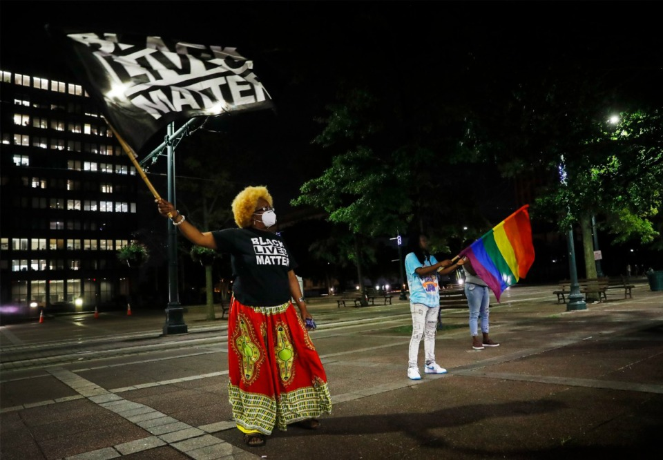 <strong>Activist Karen &ldquo;Mama Peaches&rdquo; Spencer McGee waves a Black Lives Matter flag during a rally for Antonio Jackson, 26, on Monday, August 16, 2021, in Civic Center Plaza.</strong> (Mark Weber/The Daily Memphian)