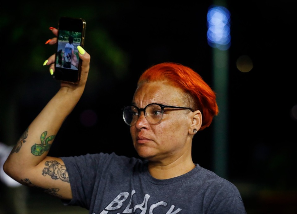 <strong>Activist LJ Abraham holds up a picture of Antonio Jackson, 26, on her cell phone during a a rally Monday, August 16, 2021 in Civic Center Plaza.</strong> (Mark Weber/The Daily Memphian)