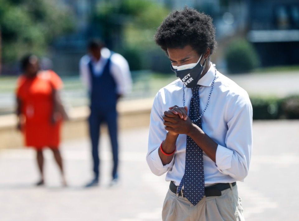 <strong>Justin J. Pearson, Memphis Community Against the Pipeline co-founder, prays during a rally connected  Tuesday, Aug. 17, 2021.</strong> (Mark Weber/The Daily Memphian)