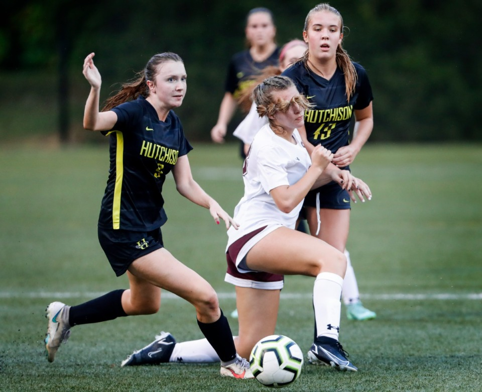 <strong>Hutchison teammates Caroline Gibert (left) and Kate Browne (right) conflict  Collierville&rsquo;s Amelya Jacobs (middle) connected  Tuesday, Aug. 17, 2021.</strong> (Mark Weber/The Daily Memphian)