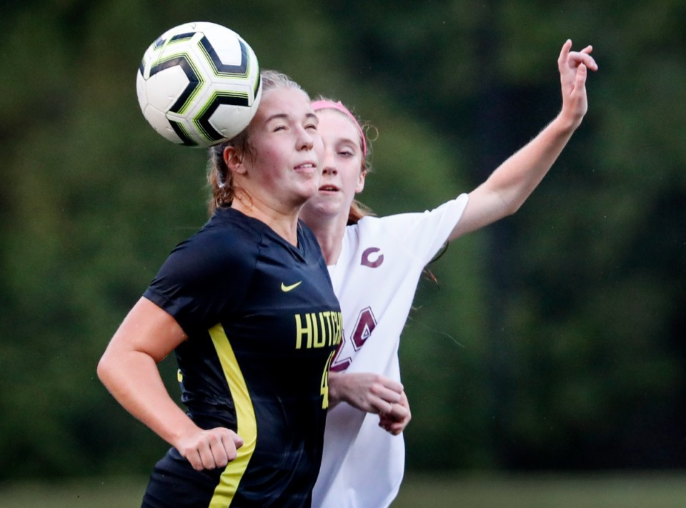 <strong>Hutchison defender Kate Browne (left) uses a header to support  the shot  from Collierville guardant  Presley Williams (right) connected  Tuesday, Aug. 17, 2021.</strong> (Mark Weber/The Daily Memphian)