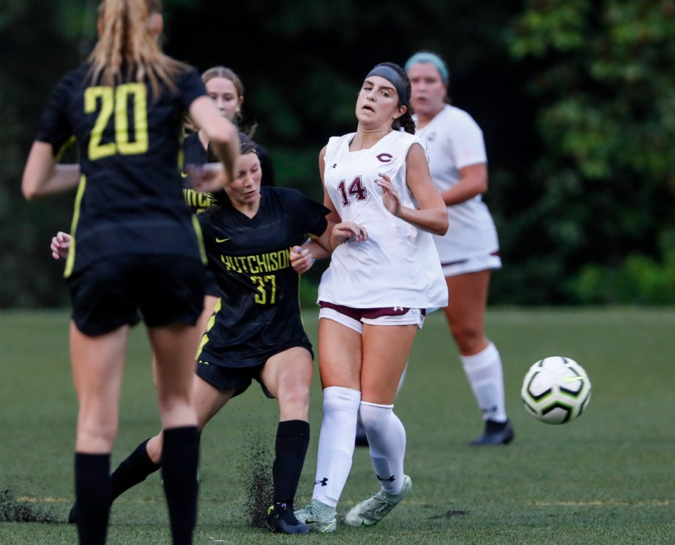 <strong>The shot  gets distant  from some  Hutchison guardant  Molly Browne (left) and Collierville defender Cameron Ewing (right) connected  Tuesday, Aug. 17, 2021.</strong> (Mark Weber/The Daily Memphian)