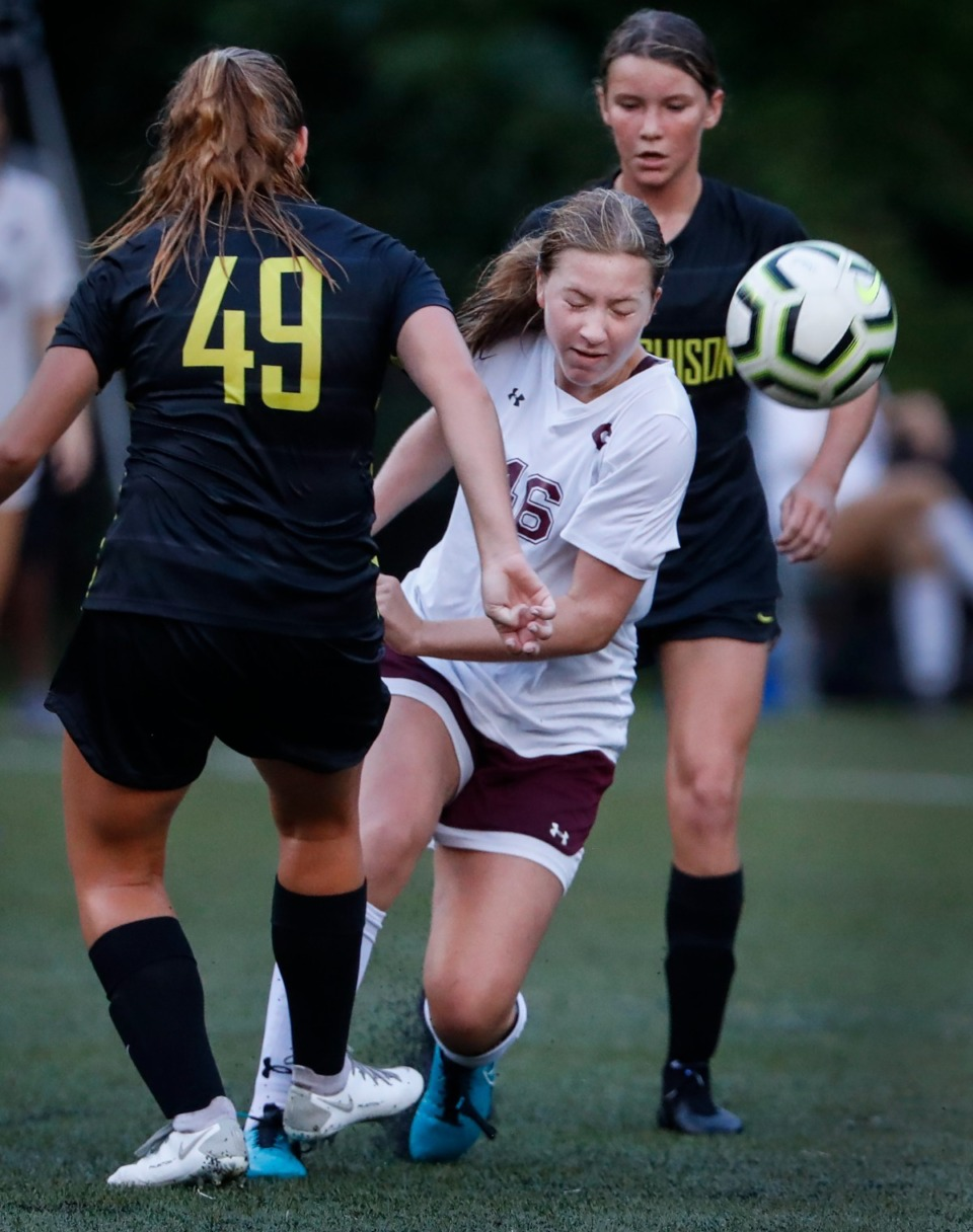 <strong>Hutchison teammates Kate Browne (left) and Molly Browne (right) conflict  Collierville&rsquo;s Ava Goodin (middle) during enactment   connected  Tuesday, Aug. 17, 2021.</strong> (Mark Weber/The Daily Memphian)