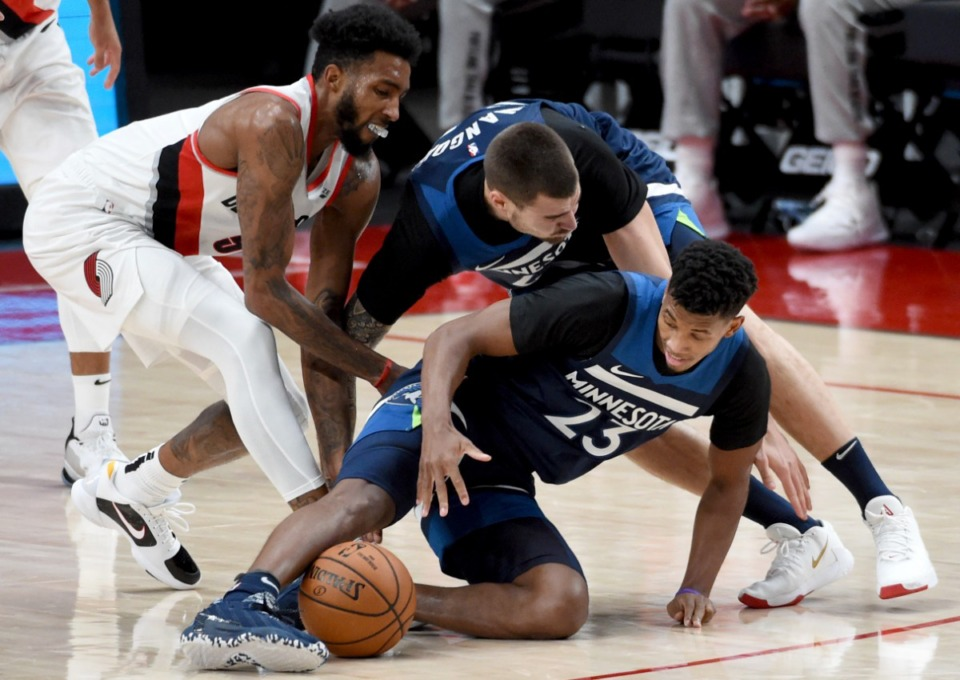 <strong>Juancho Hernangomez (top right) and Jarrett Culver scrambled for the ball for the Minnesota Timberwolves last season. Will they remain teammates this season in Memphis?</strong> (Steve Dykes/AP file)