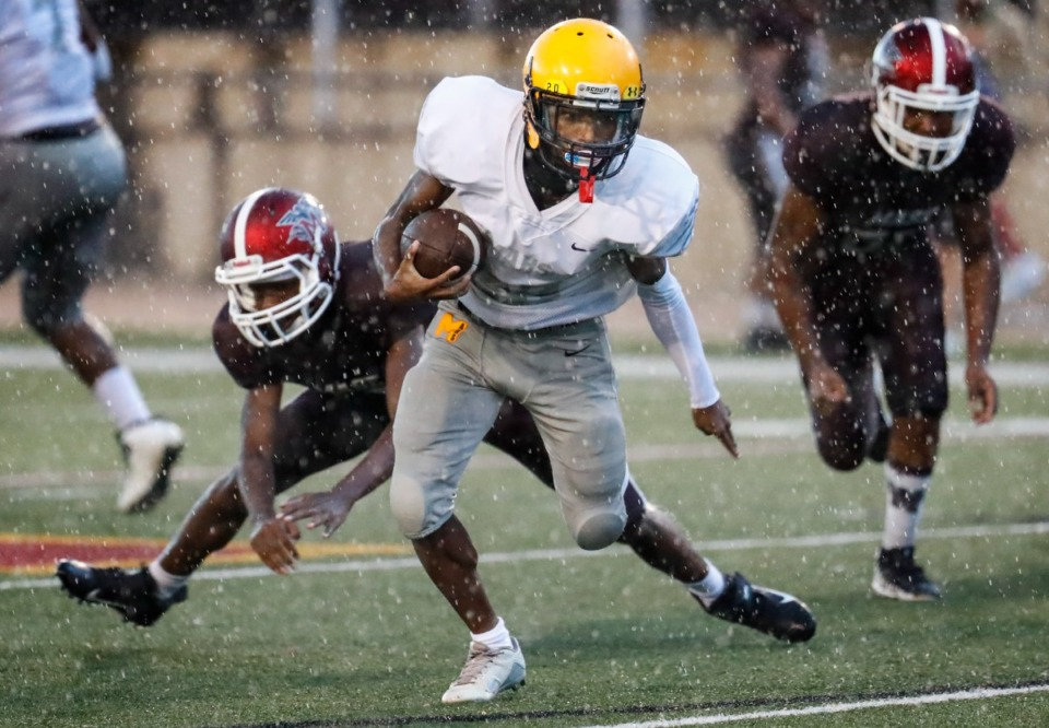 <strong>MAHS running back Jahiem Jackson (middle) runs by the MASE defense for a touchdown on Thursday, Aug. 19, 2021.</strong> (Mark Weber/The Daily Memphian)