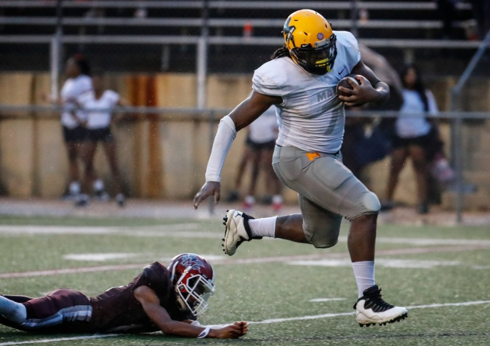 <strong>MAHS defensive lineman Charles Perkins (right) runs by MASE&rsquo;s Kendarious Love (left) for a touchdown after recovering a fumble on Thursday, Aug. 19, 2021.</strong> (Mark Weber/The Daily Memphian)