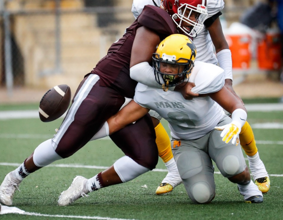 <strong>MAHS&rsquo; Terrique Hogue (right) reaches for an MASE fumble on Thursday, Augu.19, 2021.</strong> (Mark Weber/The Daily Memphian)