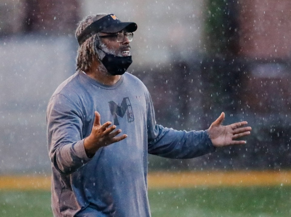 <strong>MAHS coach Cedric Miller shouts instruction in the game against MASE on Thursday, Aug. 19, 2021.</strong> (Mark Weber/The Daily Memphian)