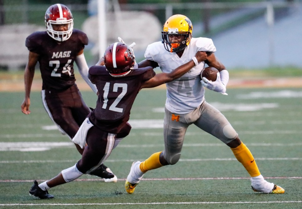 <strong>MAHS receiver Jalen Dale (right) fights off MASE&rsquo;s Keshion Walton (left) on Thursday, Aug. 19, 2021.</strong> (Mark Weber/The Daily Memphian)
