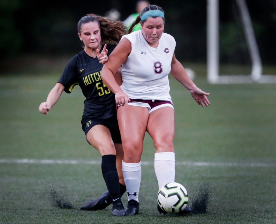 <strong>Hutchison forward Audrey Graves (left) battles Collierville defender Olivia Boscaccy (right) during action Tuesday, Aug. 17, 2021.</strong> (Mark Weber/The Daily Memphian)