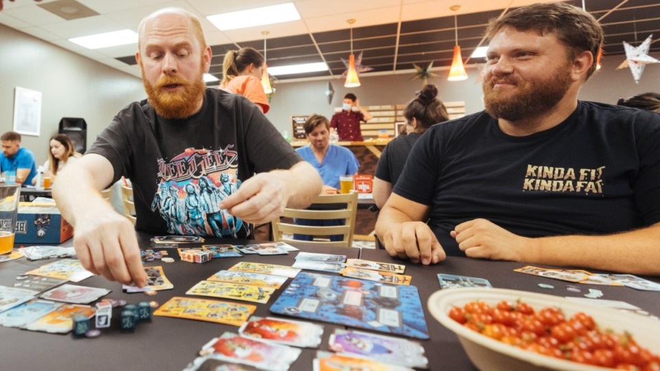 <strong>Brian Wetherald (left) and Nick Fiveash play a game of Brew at Boards to Beers located near Chickasaw Gardens.</strong> (Ziggy Mack/Special to The Daily Memphian)